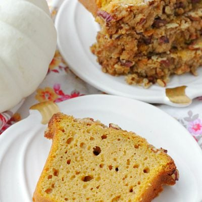 slice of really good pumpkin bread on pumpkin ceramic plate