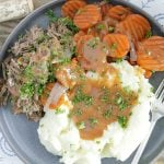 slow cooker red wine pot roast with carrots and mashed potatoes and gravy