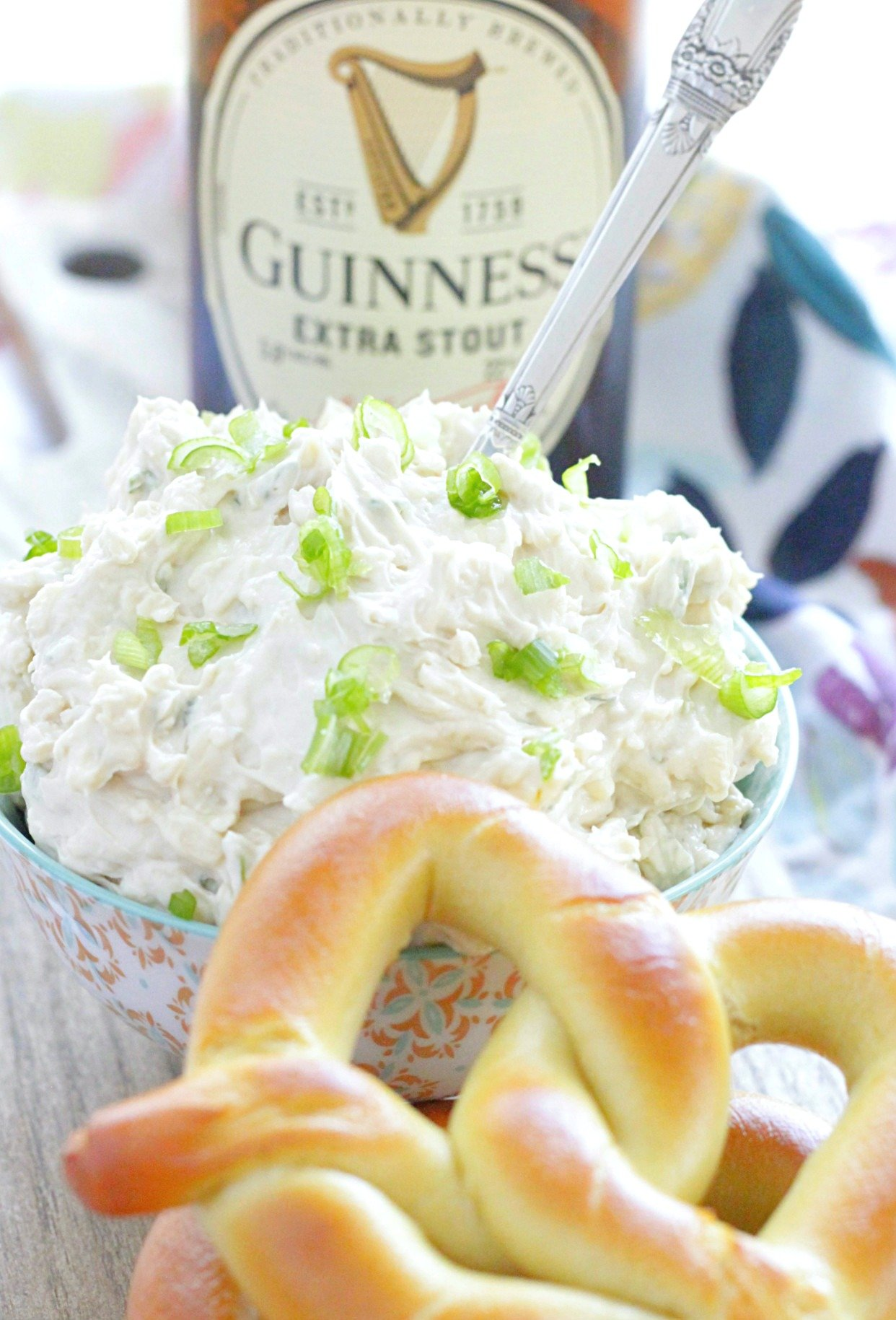 guinness cheddar dip pictured with a bottle of Guinness