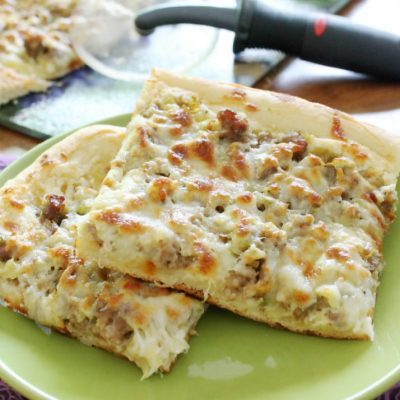 Layered Sausage and Artichoke Dip Pizza