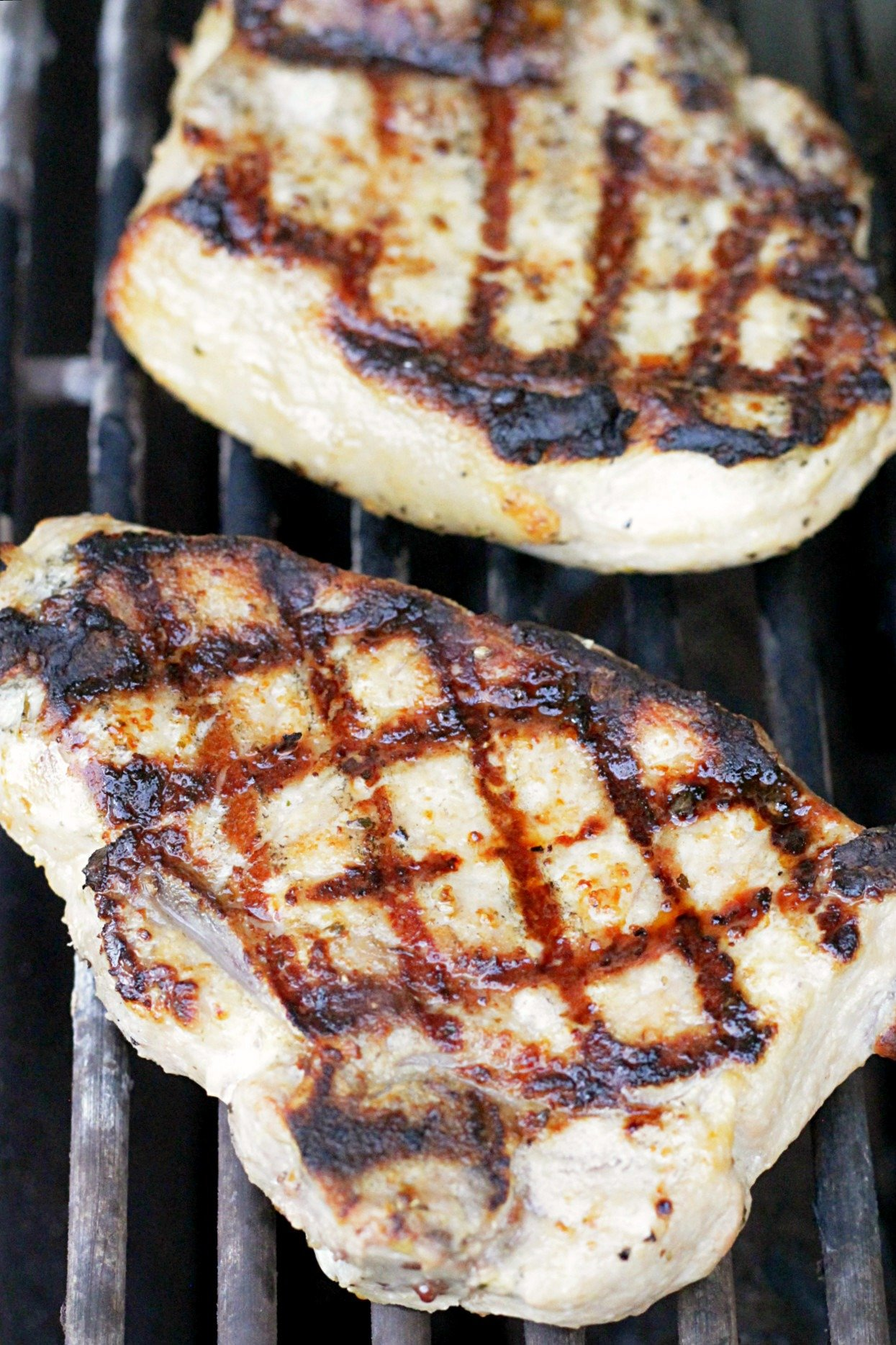 perfectly grilled pork chops on the grill