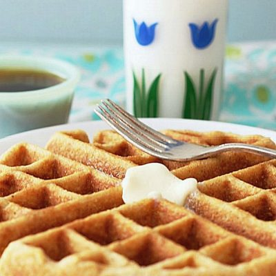 whole grain waffle on plate with glass of milk