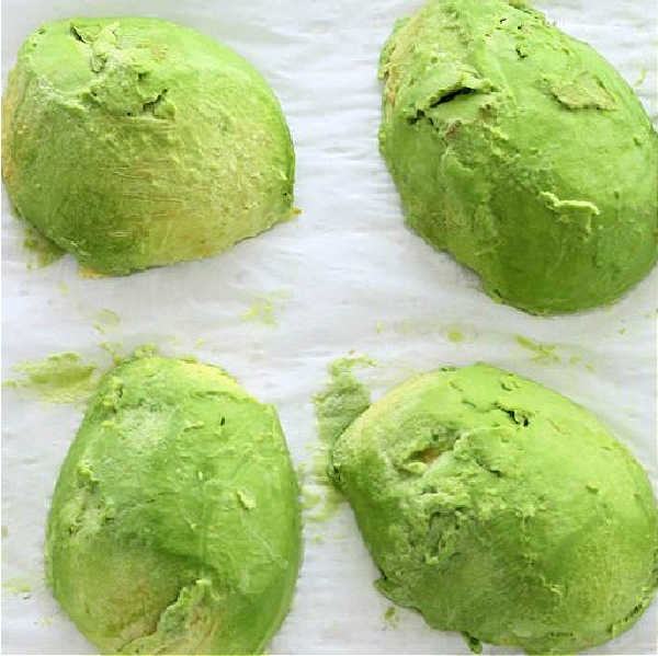 showing avocado halves ready to be preserved in the freezer