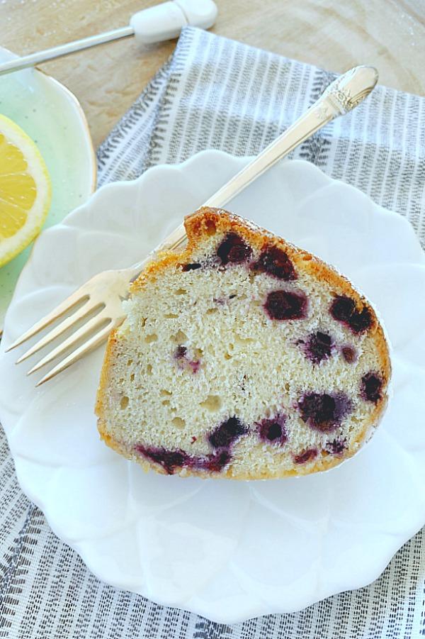slice of blueberry bundt cake on plate with fork