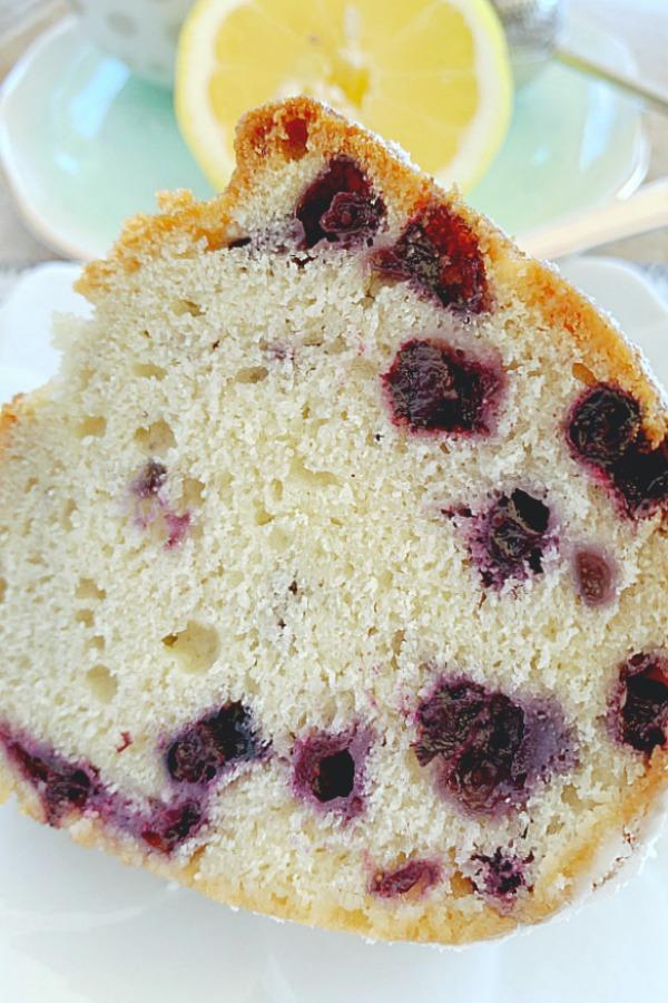 close up of slice of blueberry bundt cake