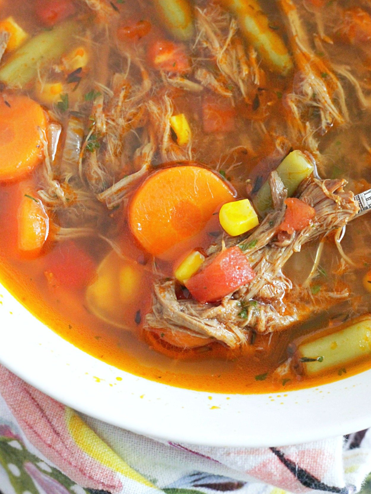 close up of beef vegetable soup in bowl