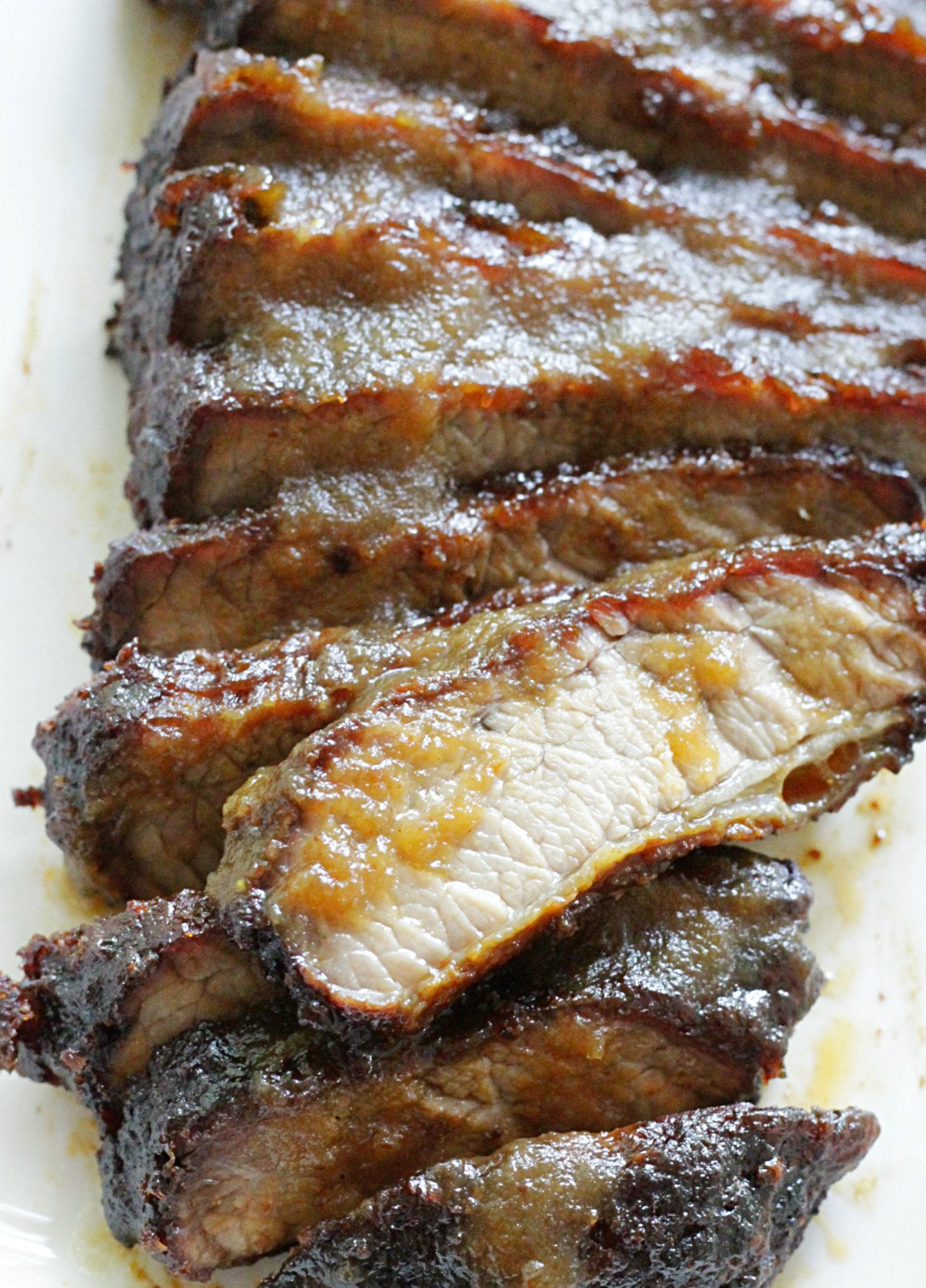 sliced brisket basted with apple butter barbecue sauce