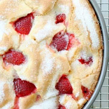overhead view of french strawberry cake in pan