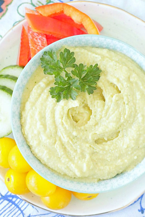 tahini free hummus in bowl with fresh vegetables