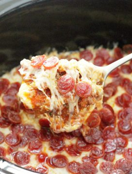 pizza dip in slow cooker with spoon