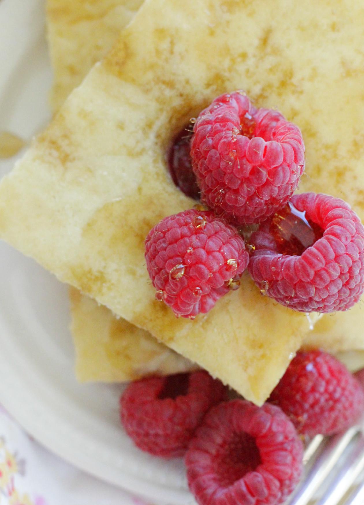sheet pan pancakes and raspberries close up