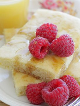 sheet pan pancakes with fresh raspberries and orange juice