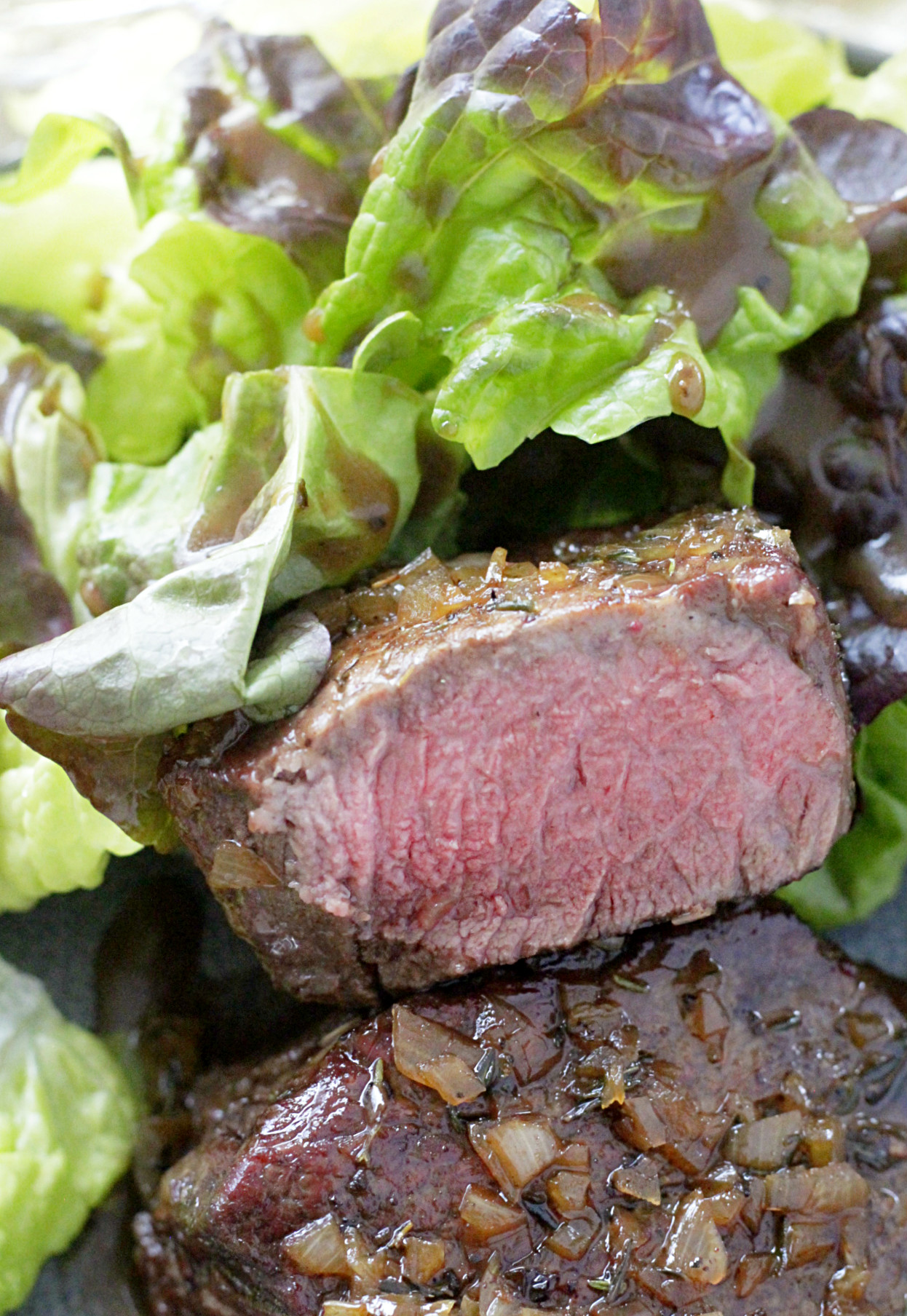 reverse sear filet with champagne butter sauce cut in half