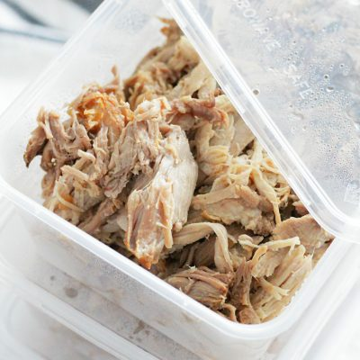 slow cooked pork portioned into individual meal prep containers