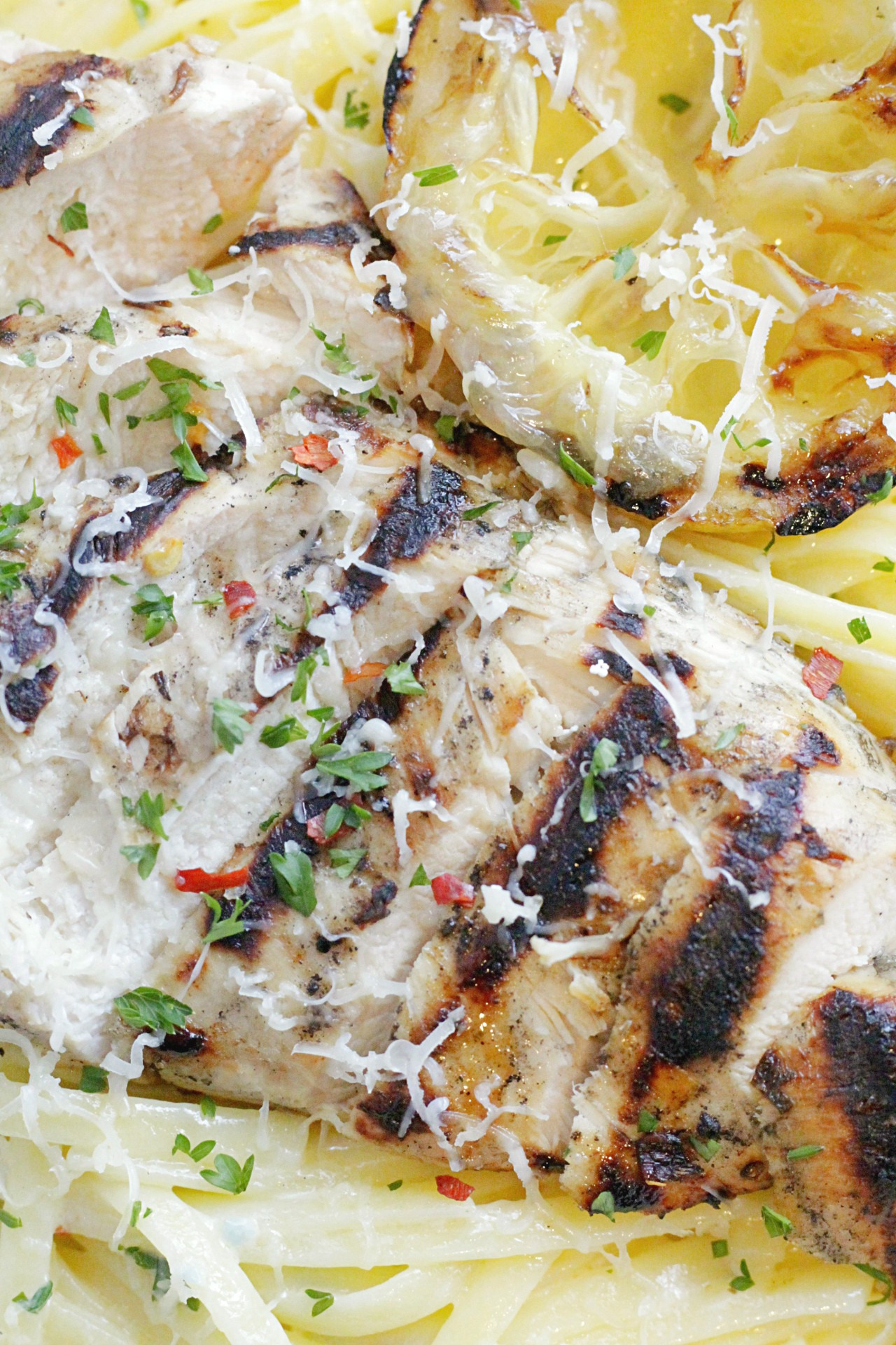 close up of grilled lemon chicken alfredo