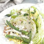 plated spring wedge salad featuring asparagus
