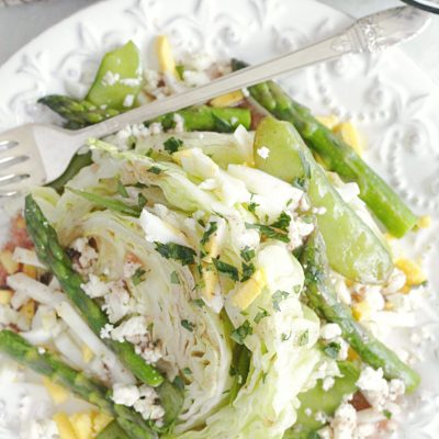 top view of spring wedge salad on plate with fork