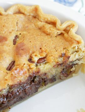 chocolate chip cookie pie - whole pie with slice cut out and view of melted chocolate chips