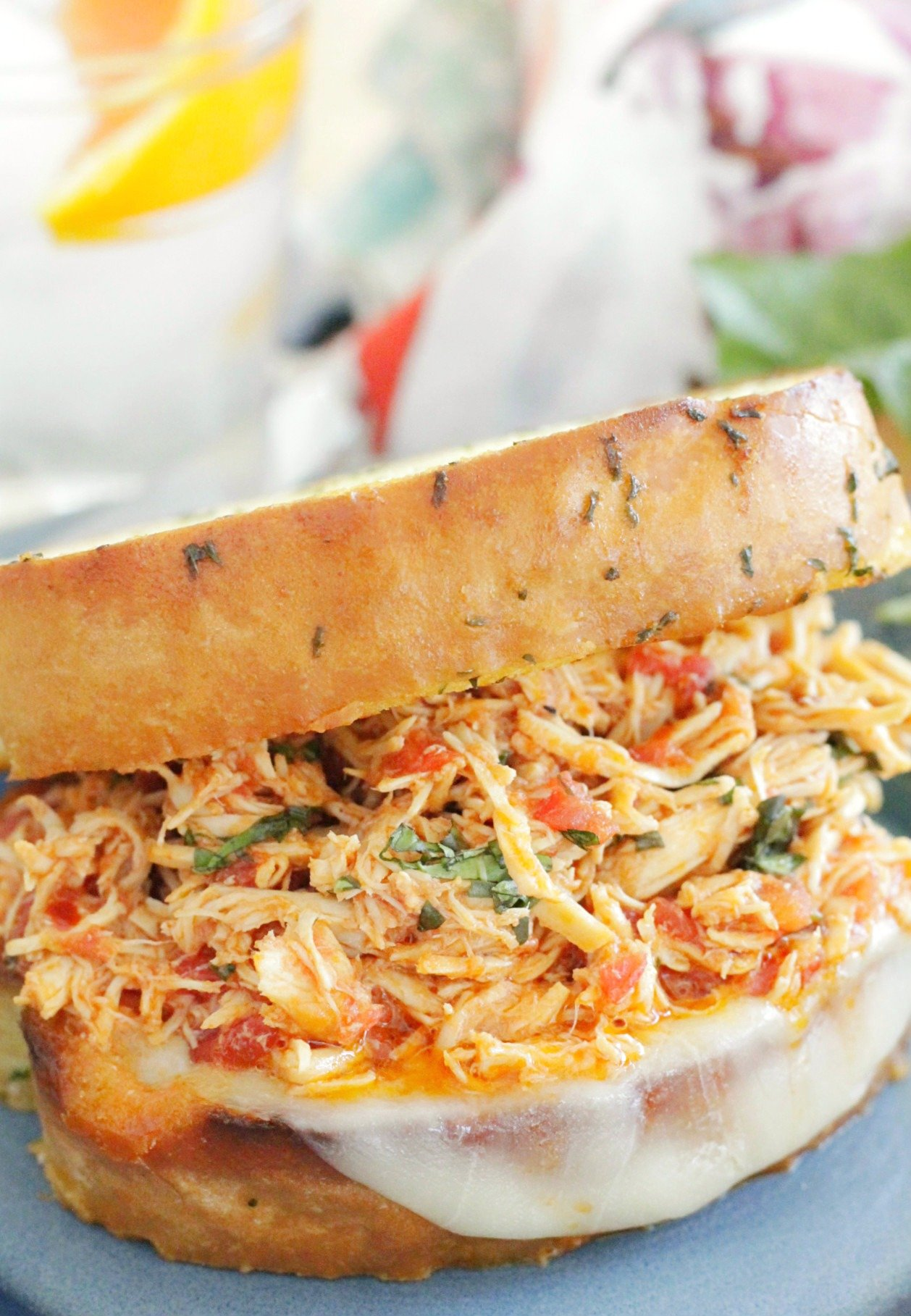 slow cooker italian chicken sandwiches - sandwich with on a blue plate