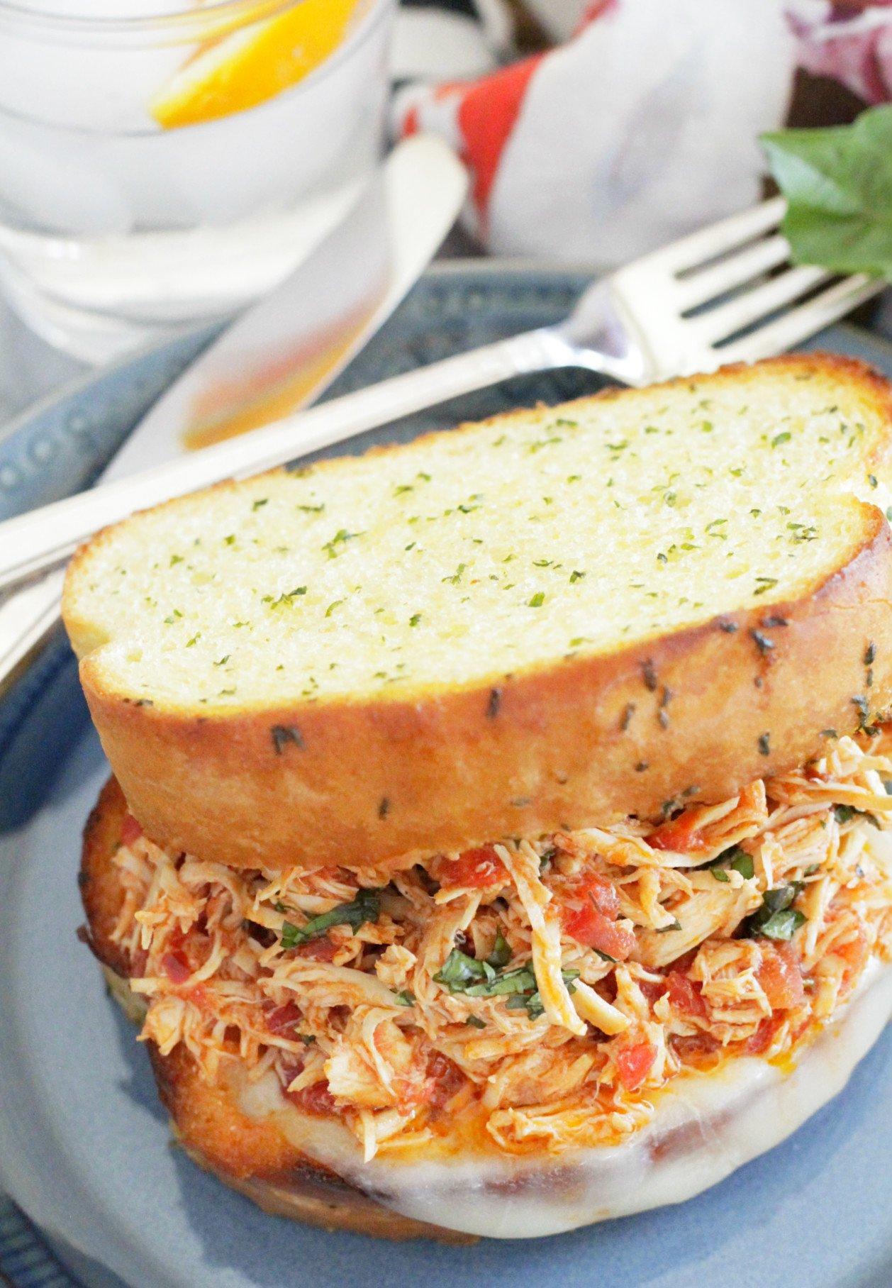 slow cooker italian chicken sandwiches - sandwich on blue plate