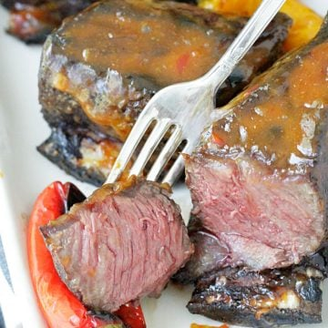 grilled short ribs with asian peanut sauce short ribs sliced in half to show cooked inside