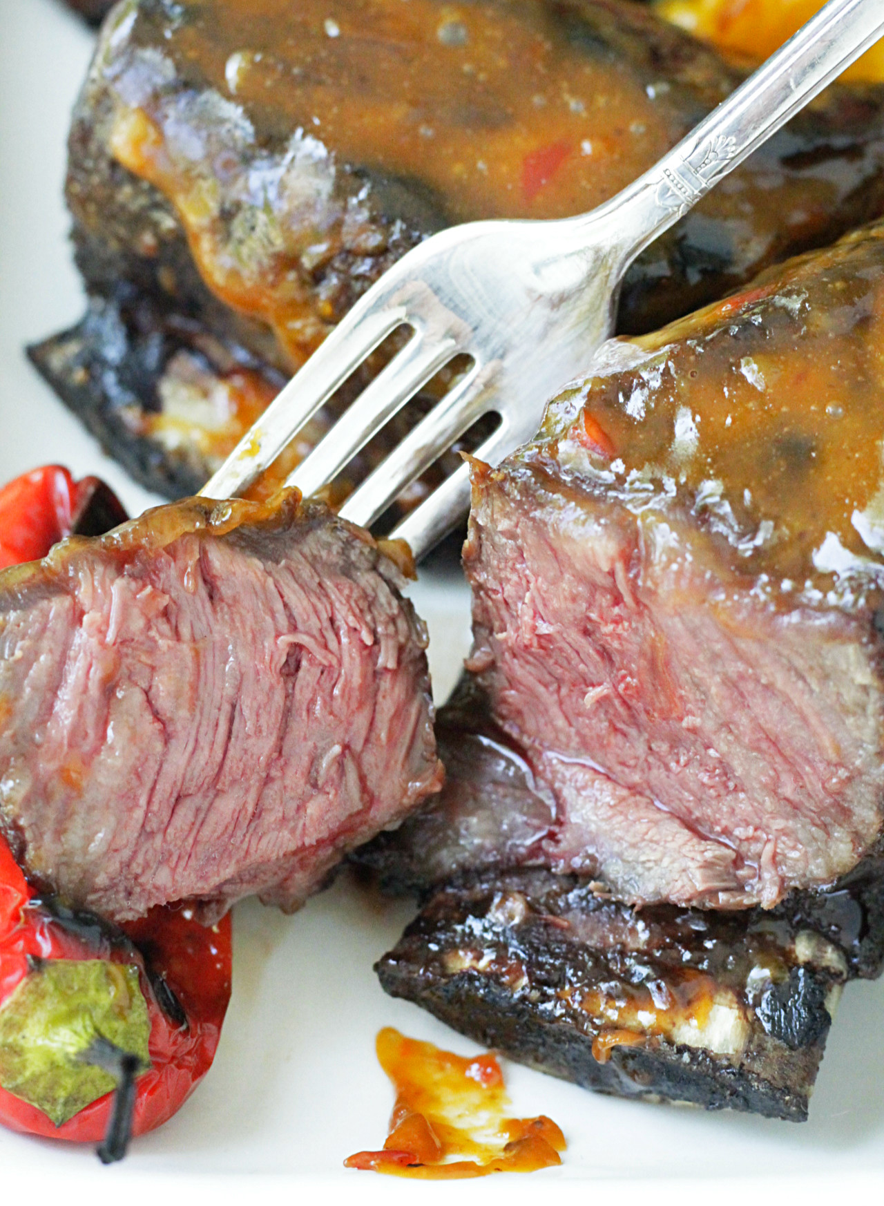 grilled short ribs with asian peanut sauce close up of sliced short rib