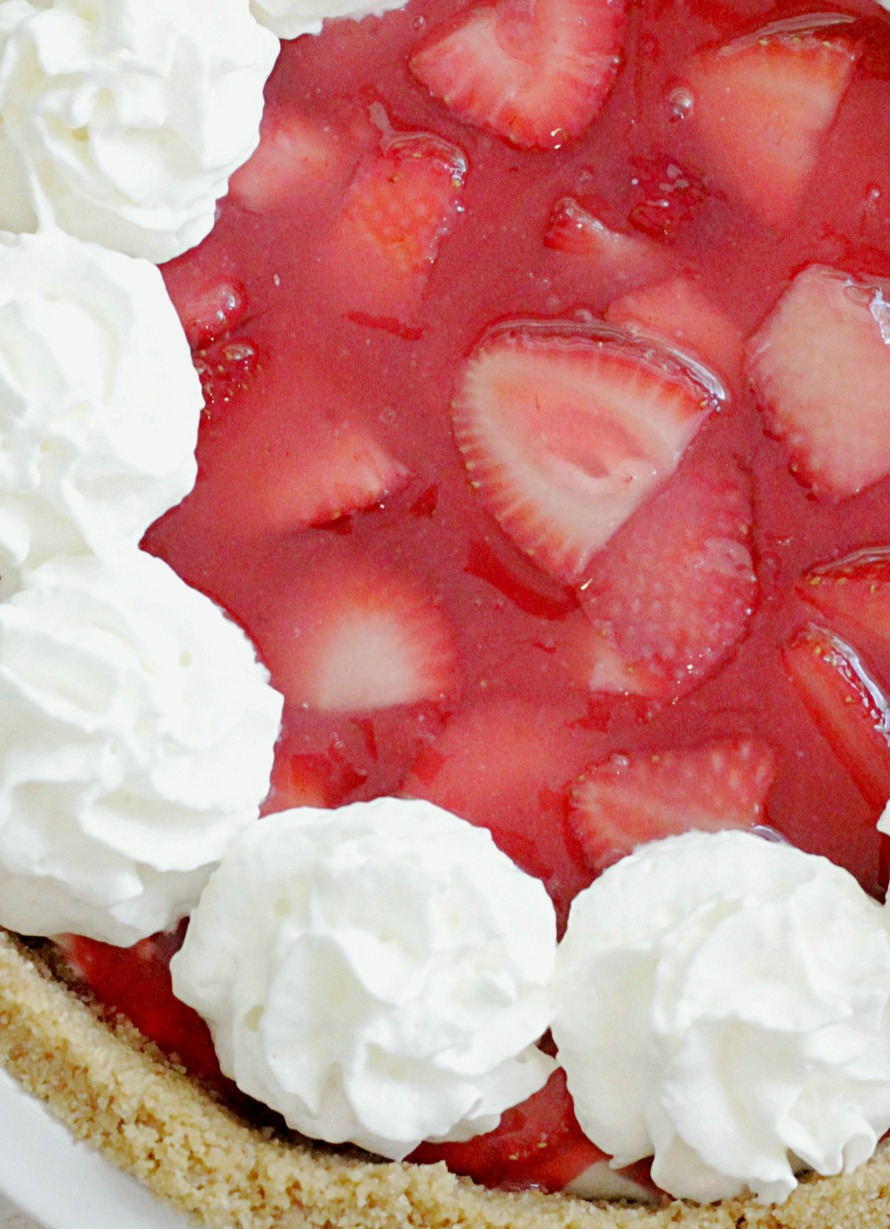 close up view of fresh strawberry cheesecake pie