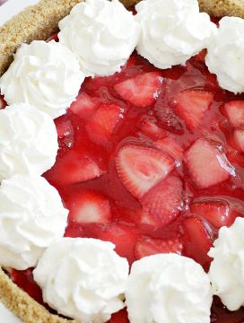 overhead view of whole fresh strawberry cheesecake pie