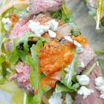open face grilled steak sandwich top view close up