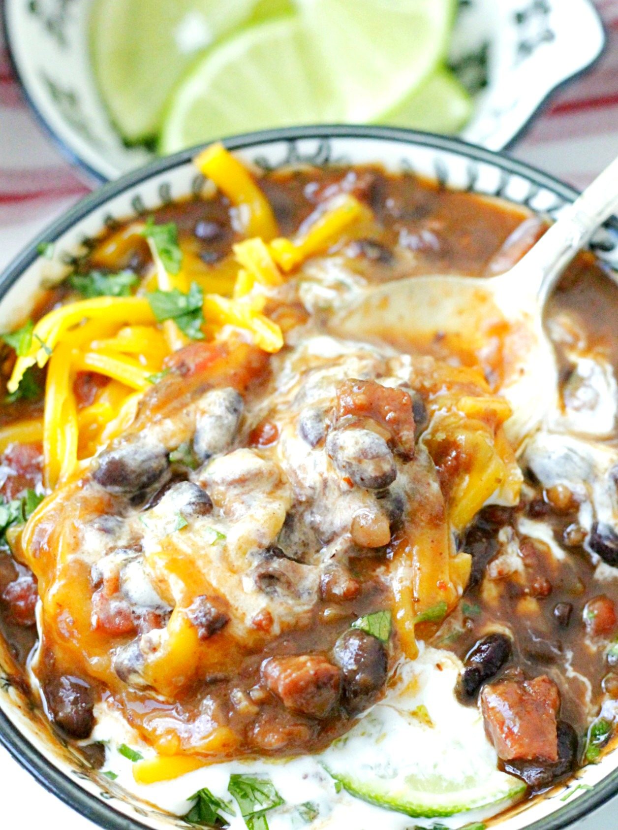 wicked black bean and ghost pepper sausage soup stirred together with sour cream