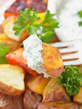 close up view of oven roasted potato on fork