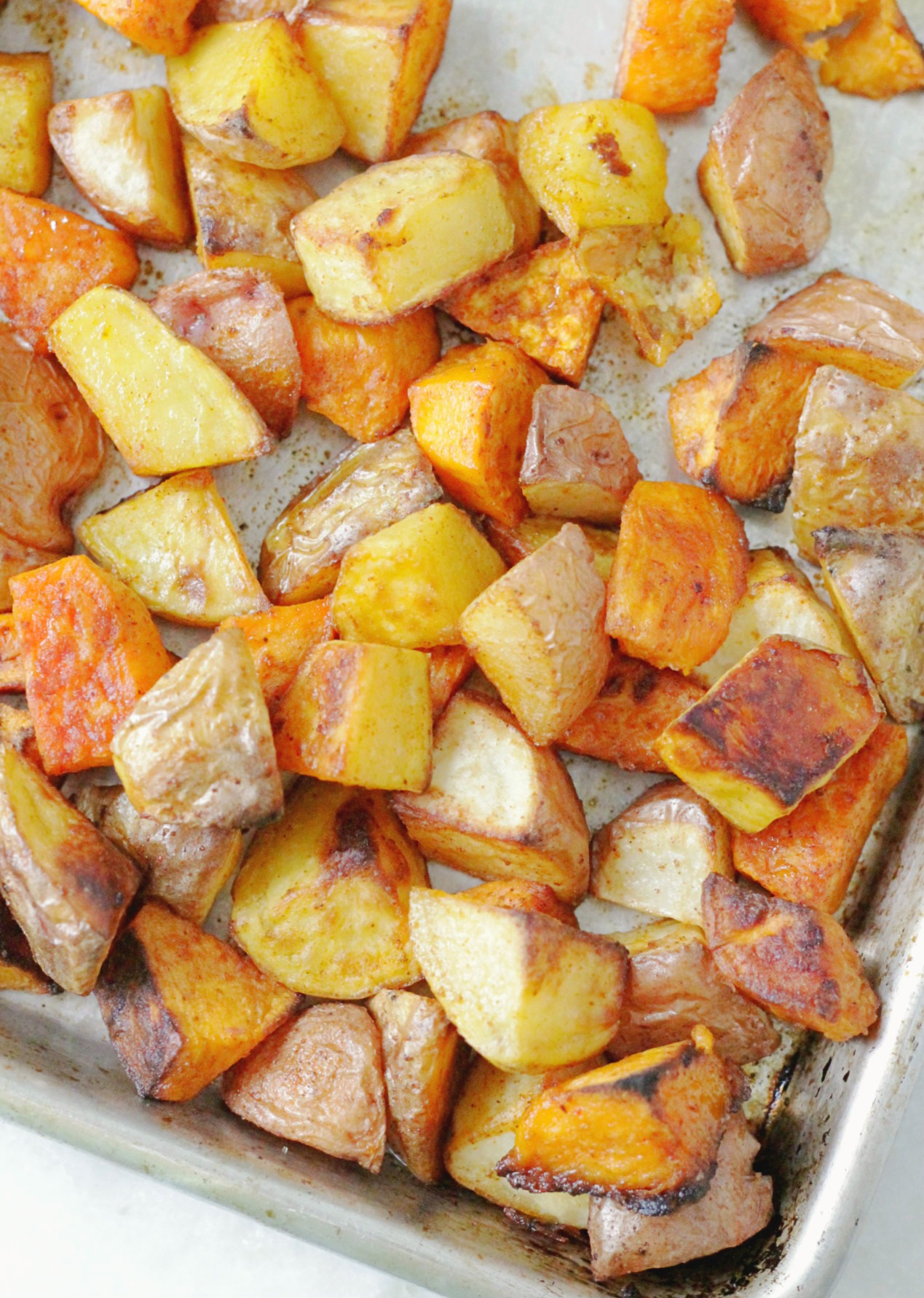 perfect oven roasted potatoes overhead view on a sheet pan
