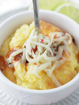 pepper jack cheese grits in bowl with spoon