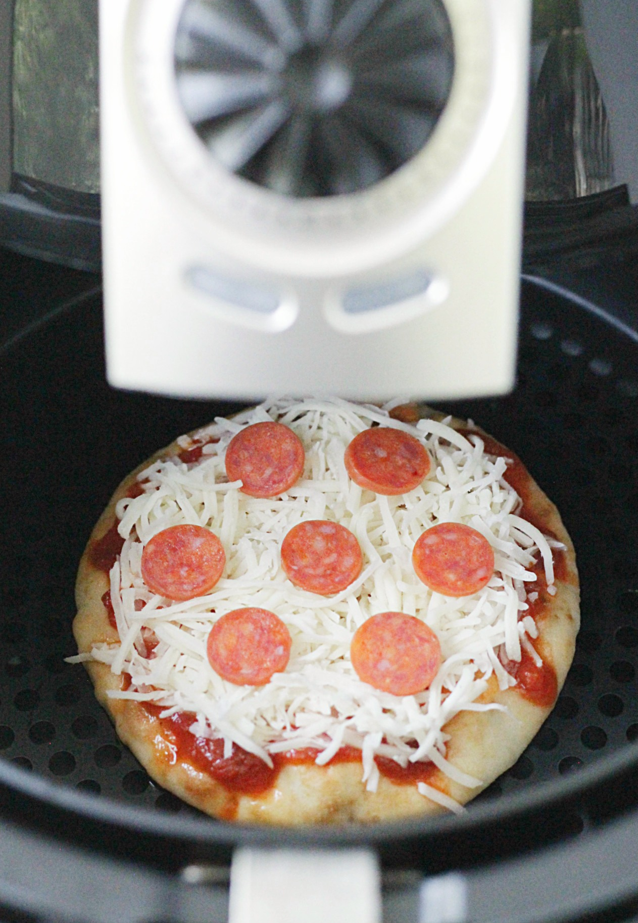 perfect personal pizza in an air fryer before being cooked