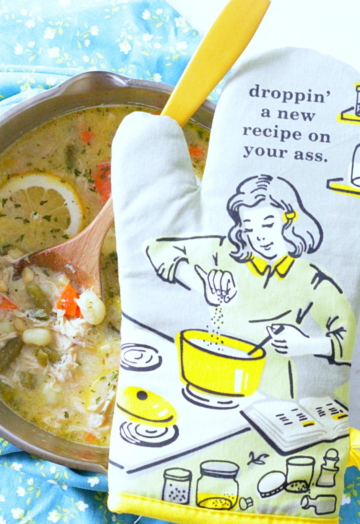 creamy lemon chicken gnocchi soup with oven mitt