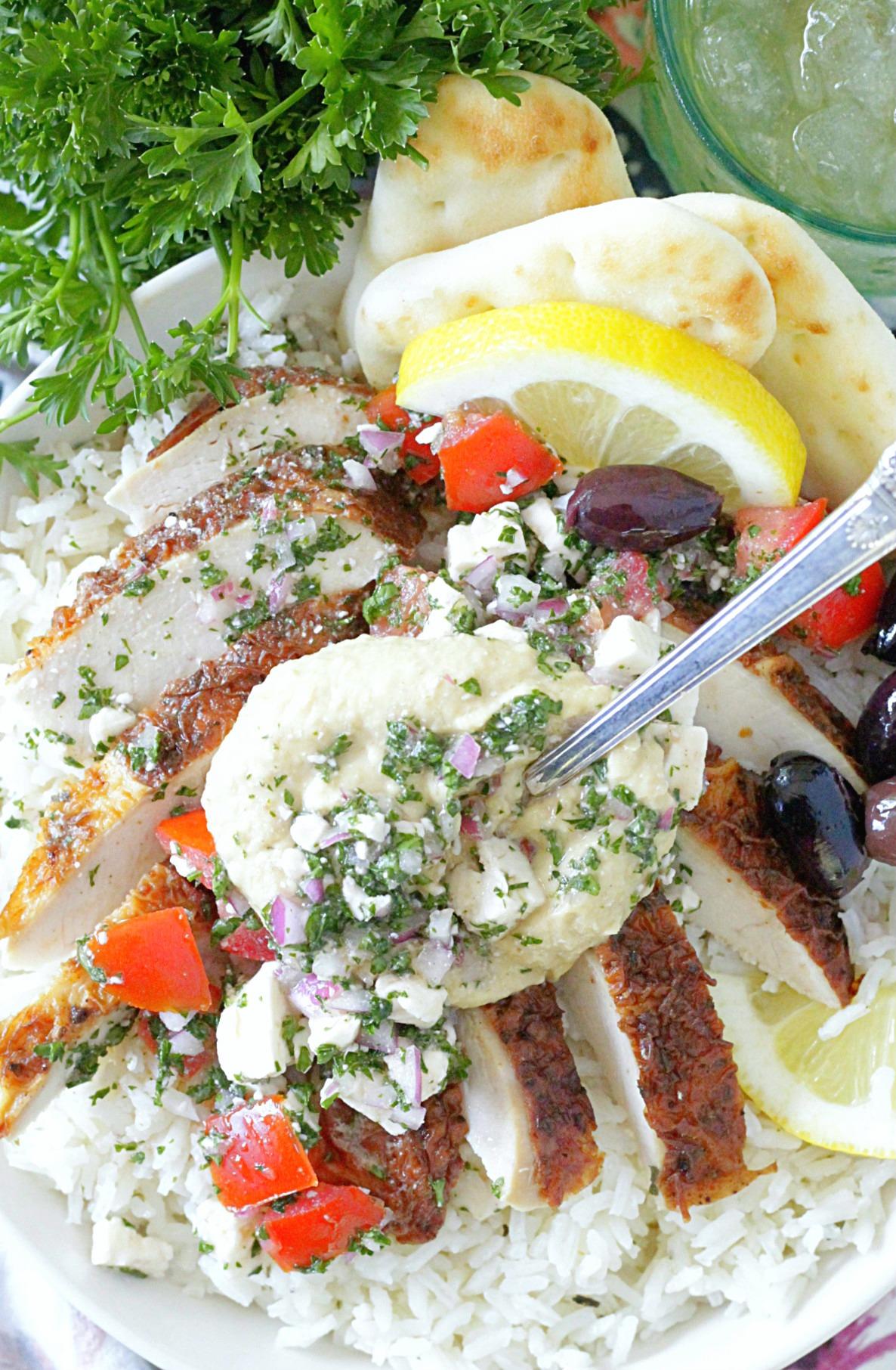 greek chicken rice bowls overhead view