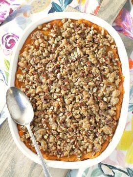 sweet potato pumpkin casserole in dish with spoon