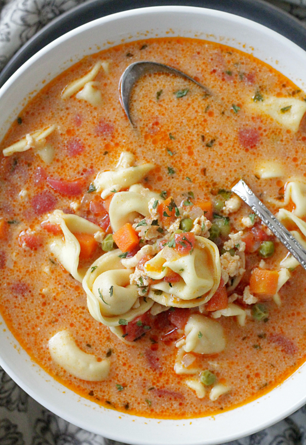 creamy cheese tortellini soup in bowl