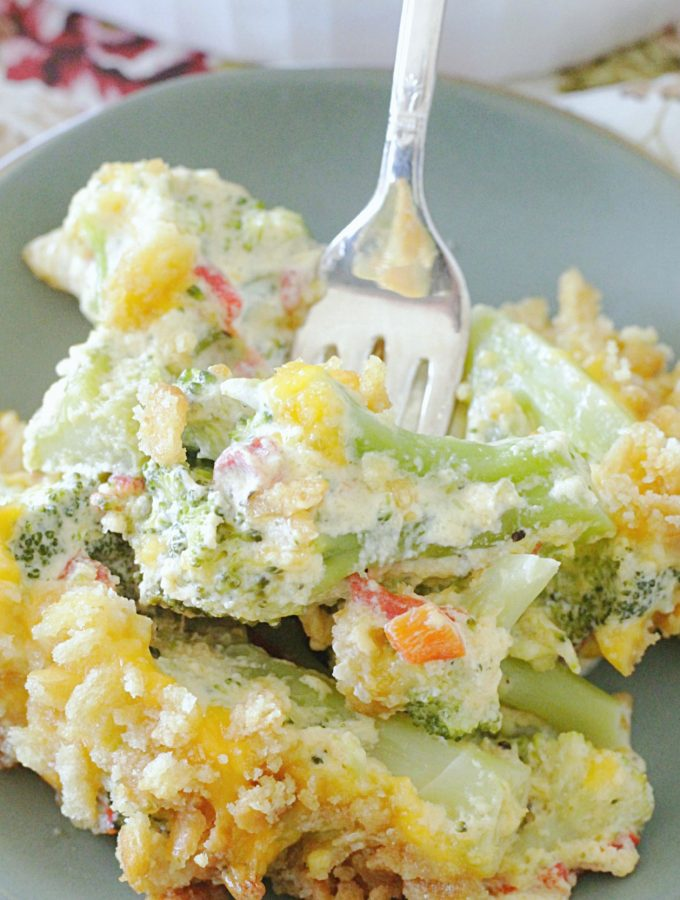 cheesy pimento broccoli casserole on plate with fork