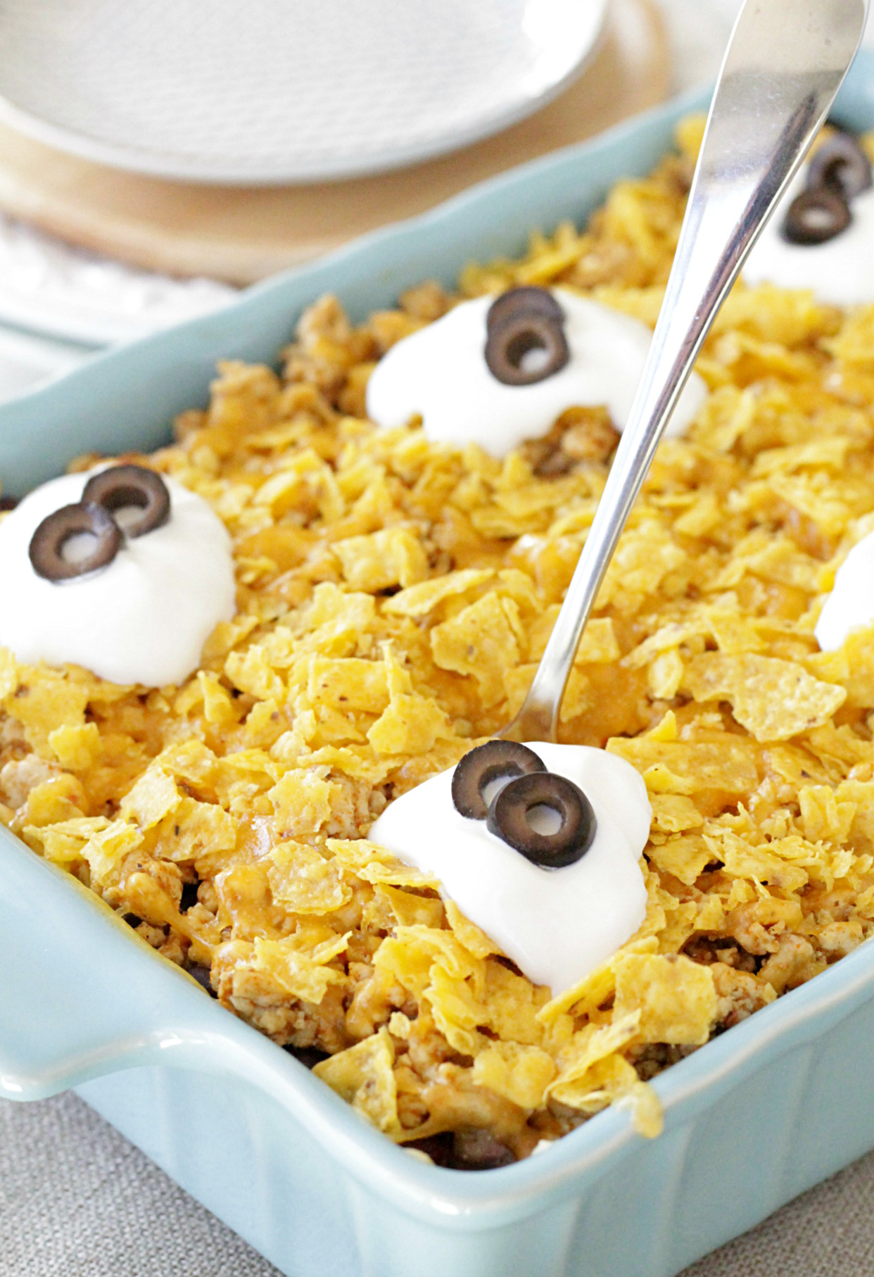 cheesy mexican rice casserole in dish with spoon
