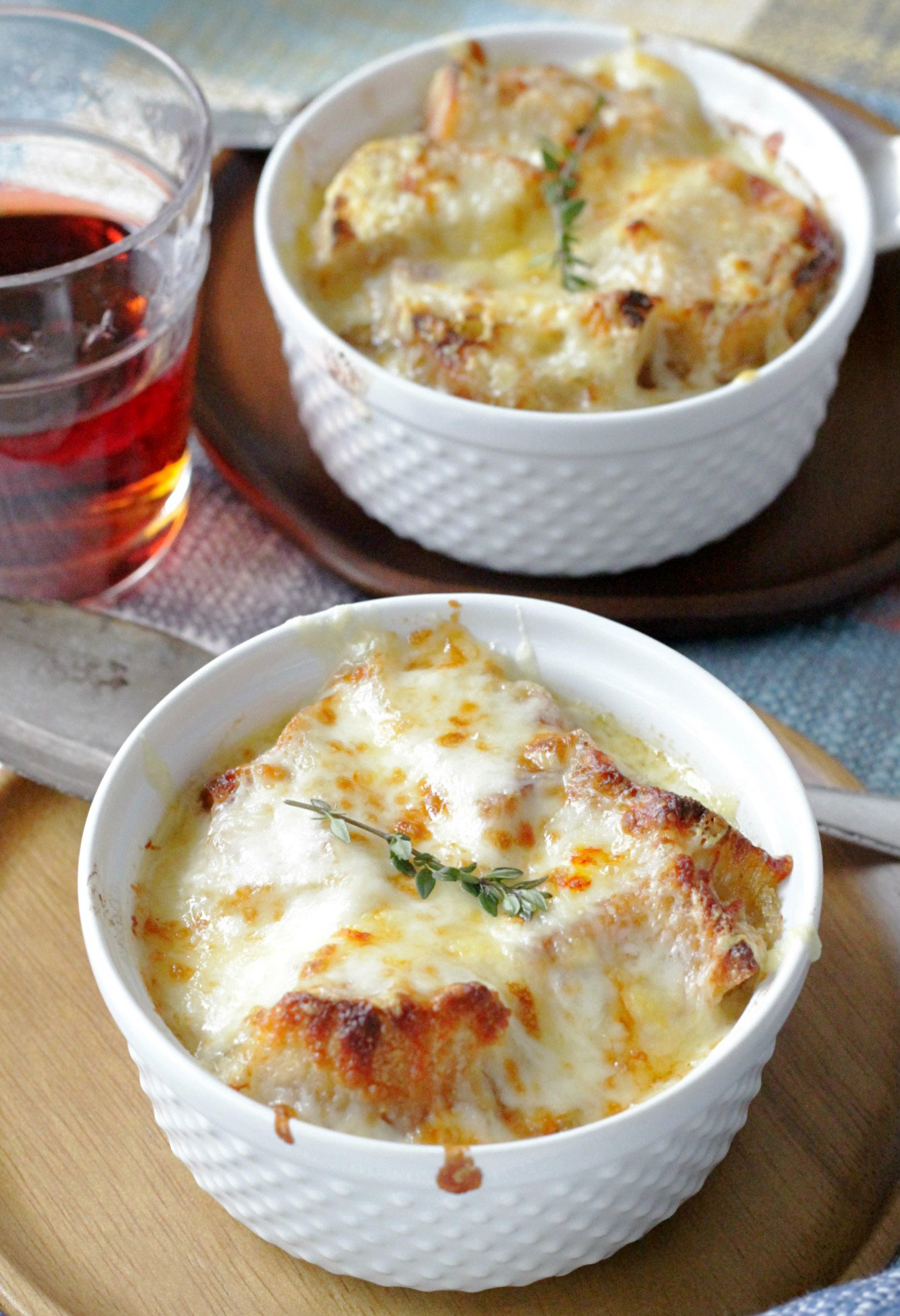 french onion chicken soup side view with two bowls