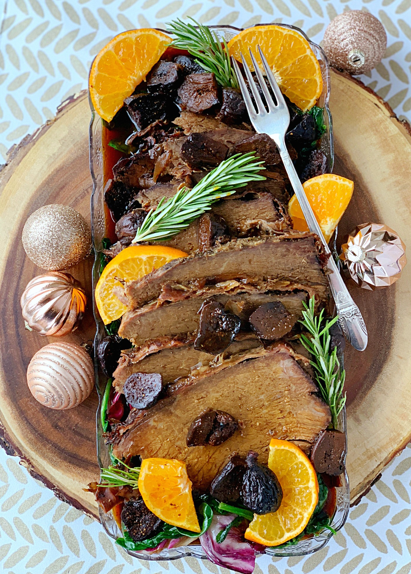 slow cooker rump roast with prosciutto and figs overhead view on platter