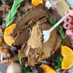 slow cooker rump roast with prosciutto and figs close up of beef on fork