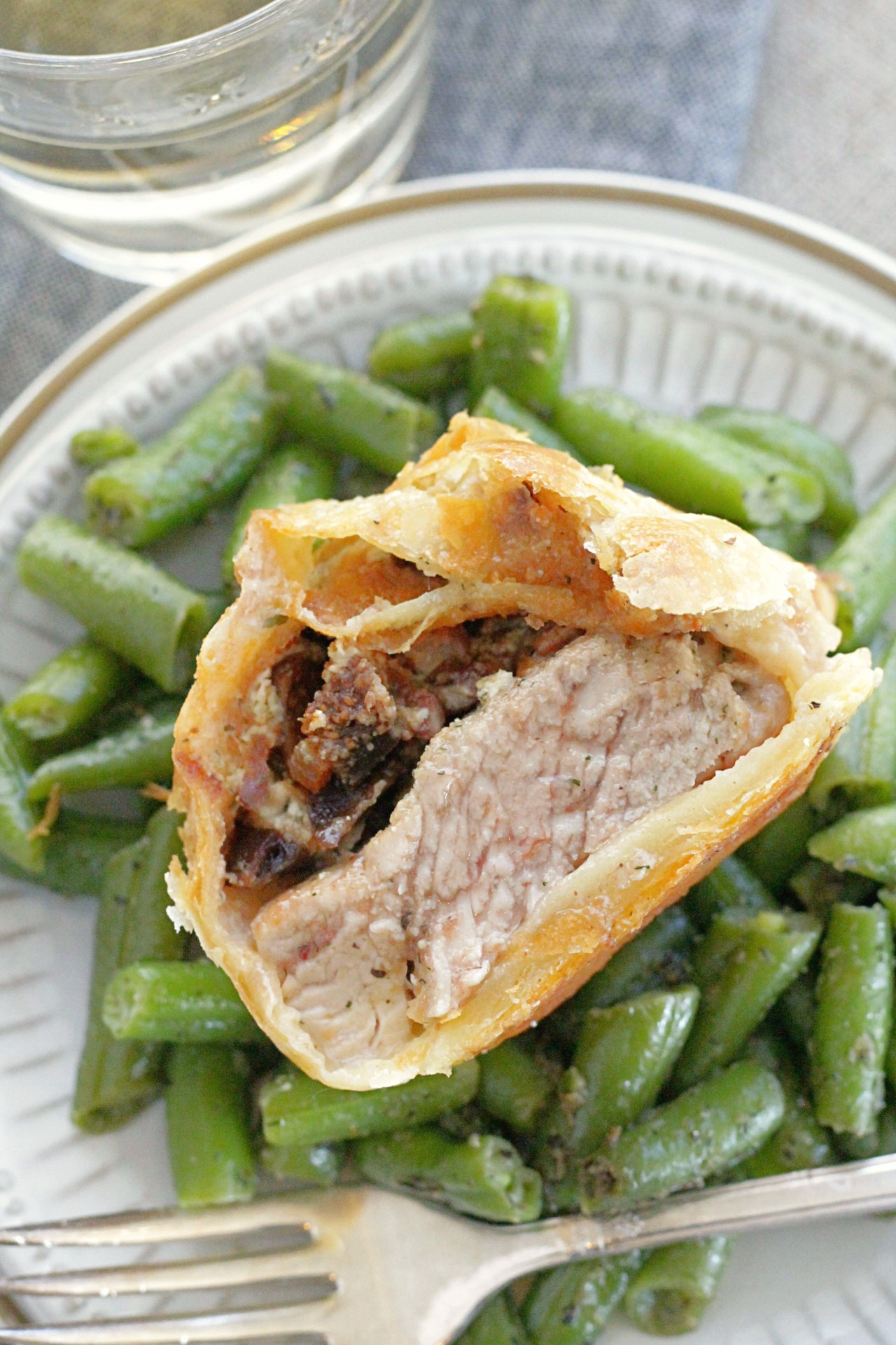 individual pork wellingtons recipe, wellington sliced in half