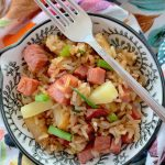 easy fried rice with ham and pineapple in bowl with fork