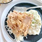 slow cooker pork and sauerkraut on plate with mashed potatoes