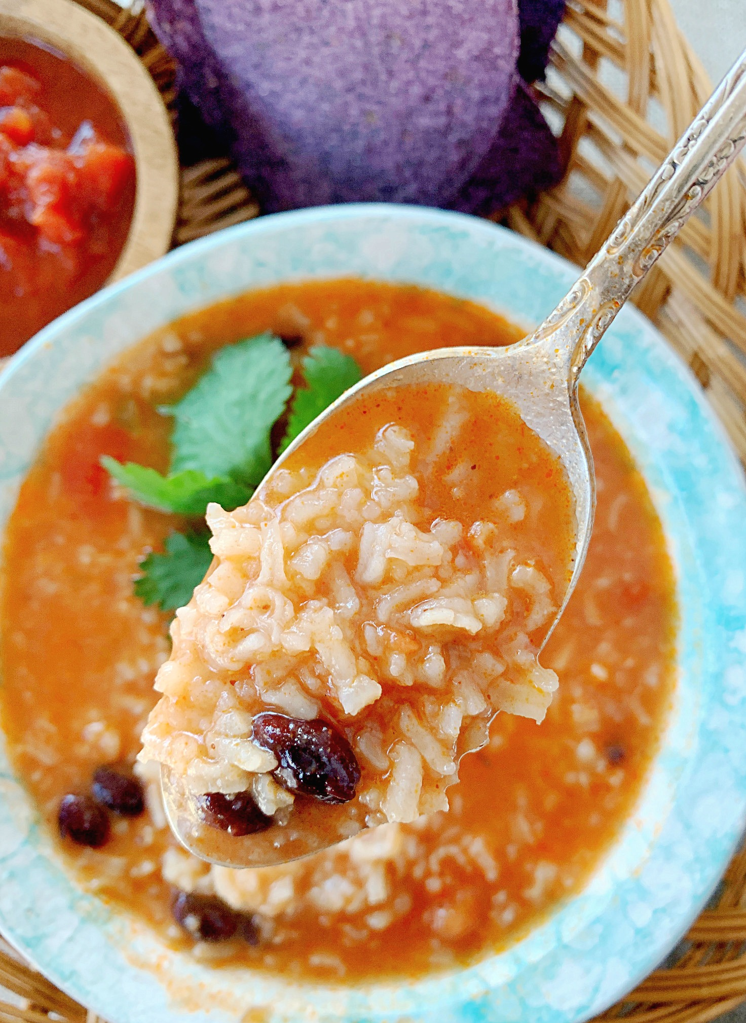 mexican rice and bean soup in a bowl with a spoon