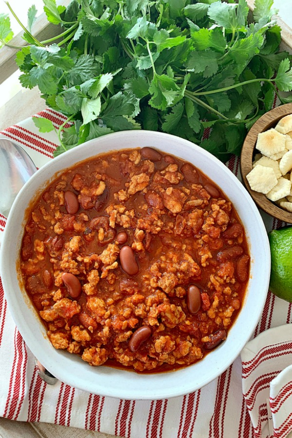 crockpot turkey chili in a bowl - overhead view