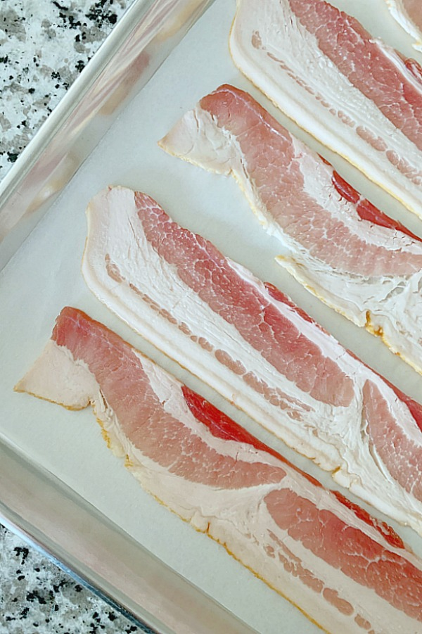 showing how to bake bacon on sheet pan with parchment paper