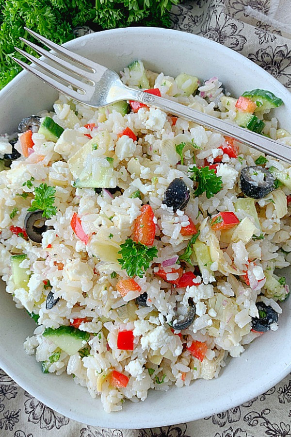 overhead view of greek rice salad in bowl